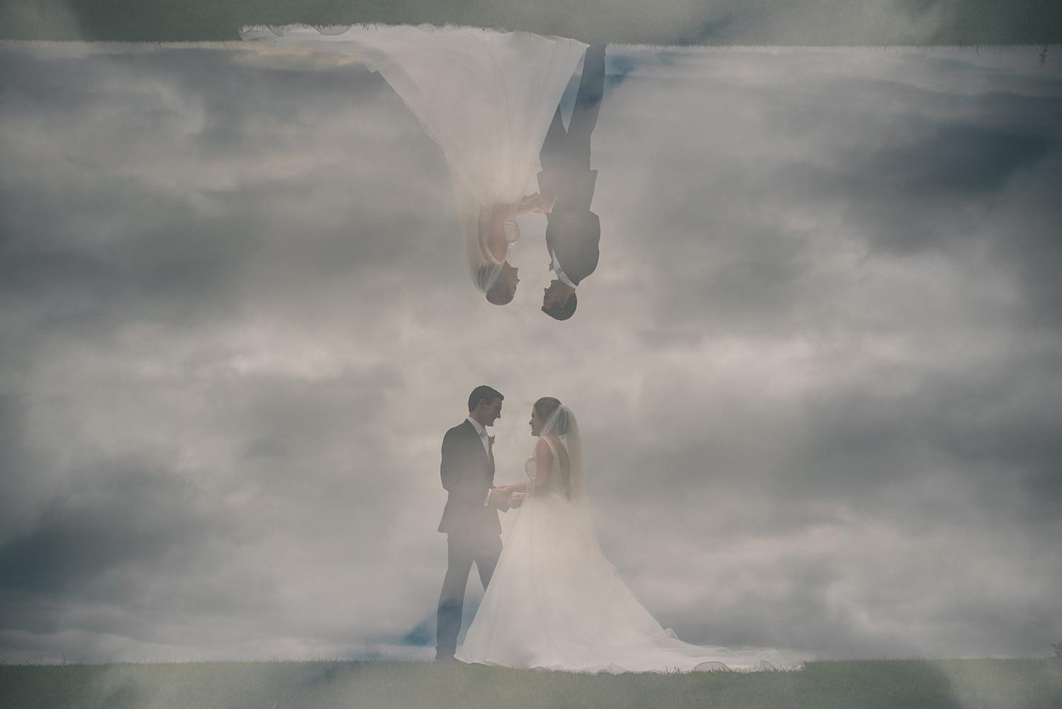 Silhouetted photo of bride and groom
