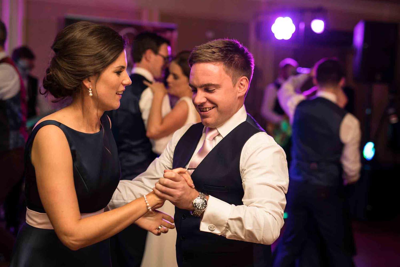 Best man and bridesmaid enjoying a dance