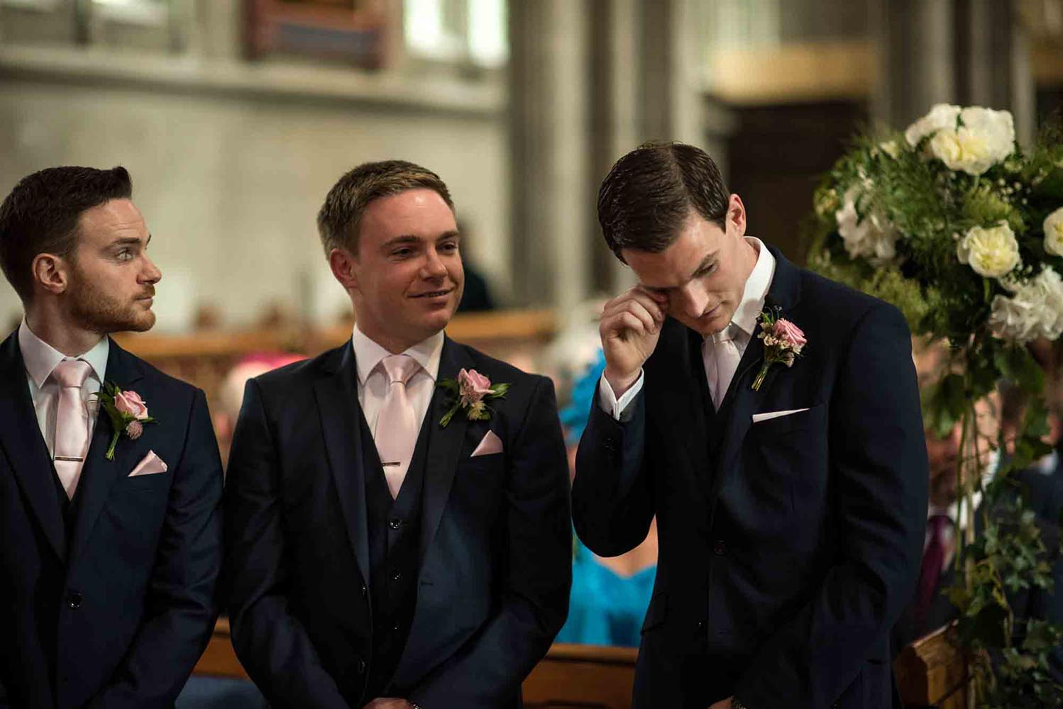 Groom and bestman waiting for bride