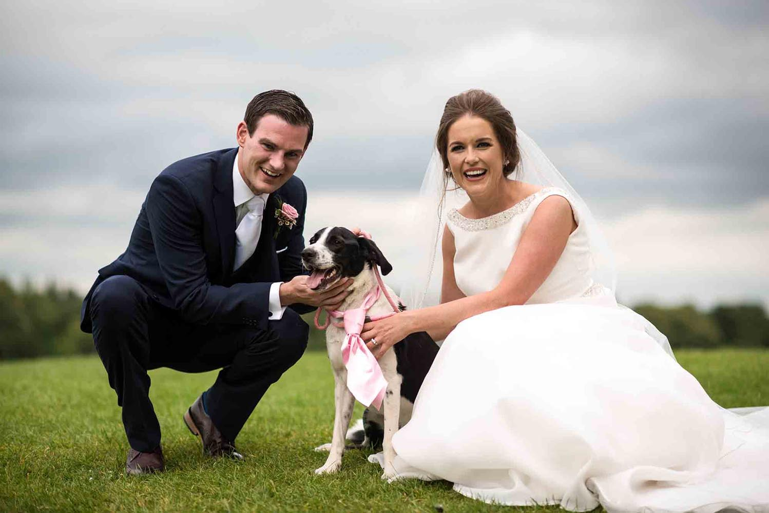 Couple with their dog on their wedding day