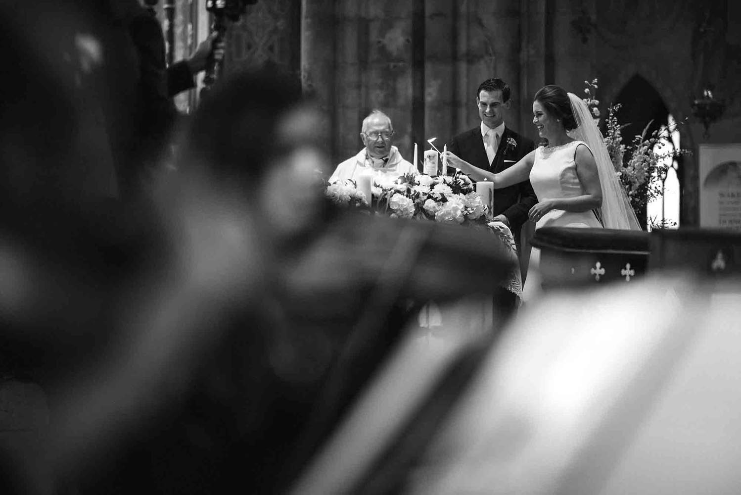 Bride and Groom lighting candles in Kilkenny Cathedral