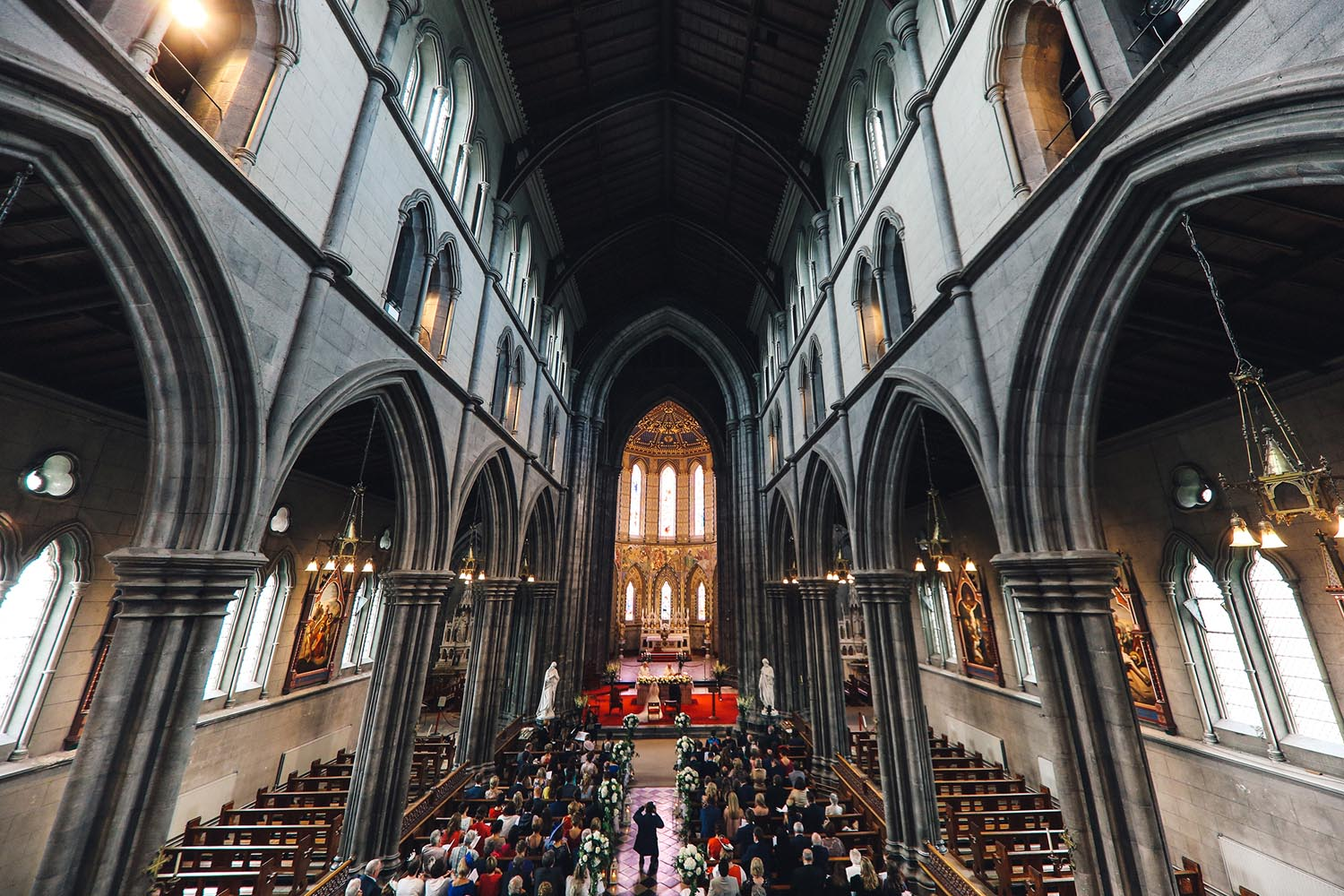 Shot of wedding guests in a Cathedral taken from above