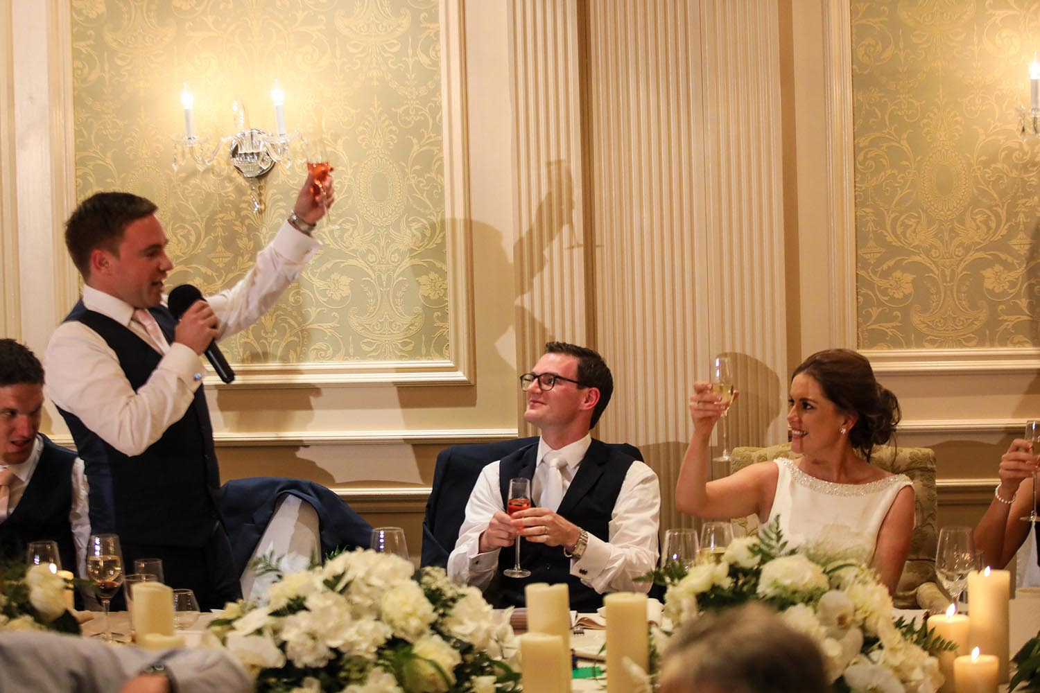 Raising a toast to a married couple on their wedding day
