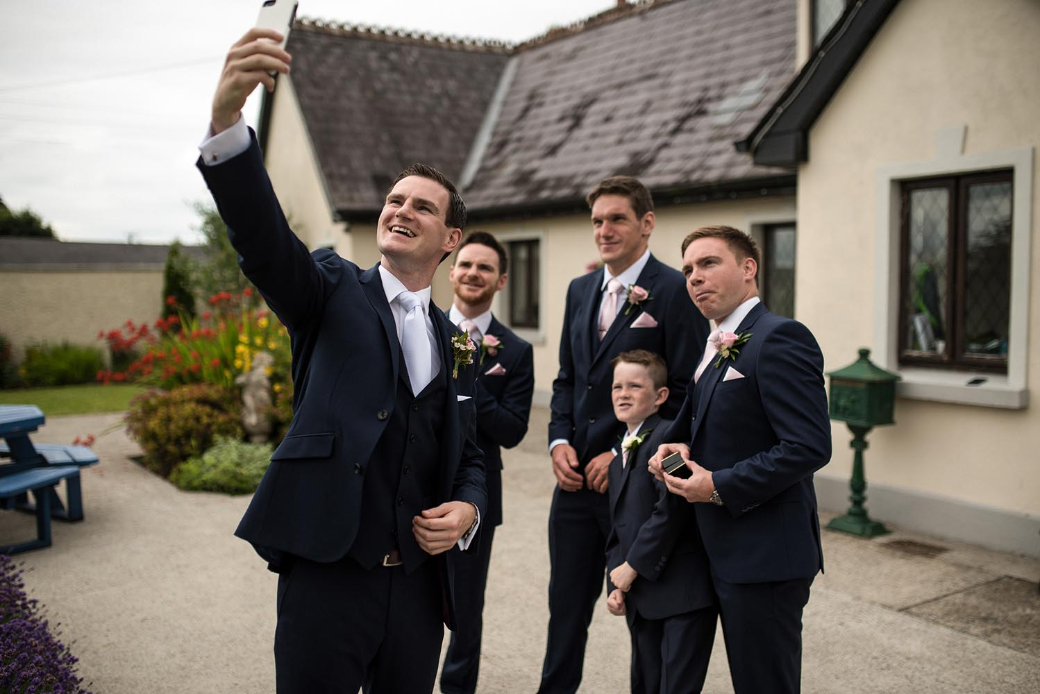 Groom taking a selfie the morning of his wedding