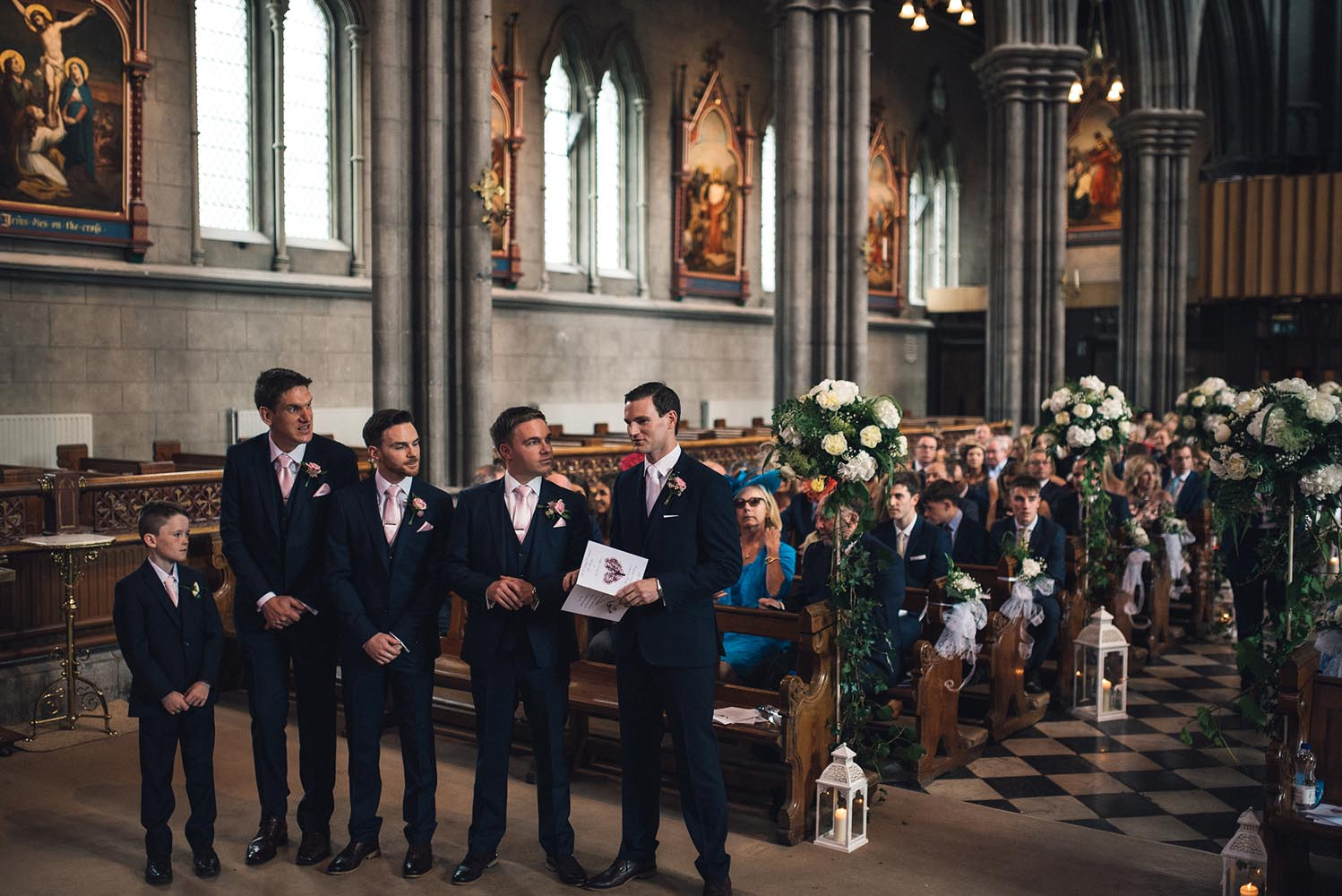 Groom and groomsmen waiting for bride to arrive