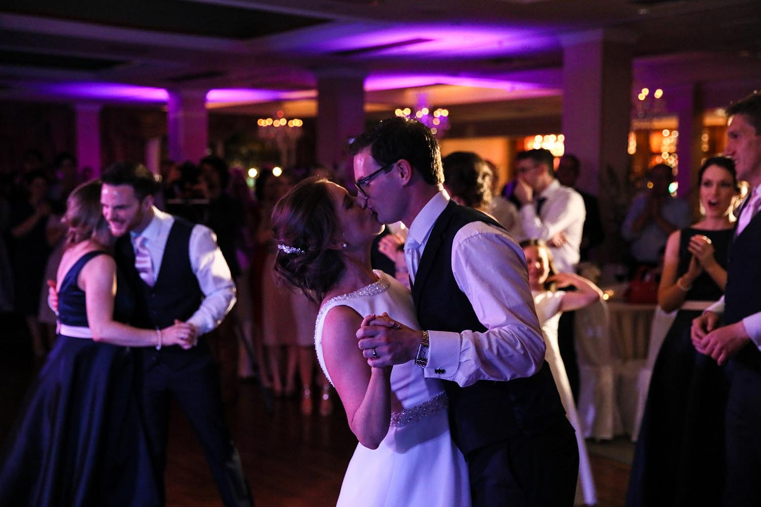 Couple kiss during their first dance